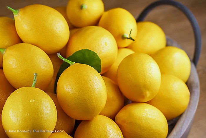 Pile of fresh meyer lemons; Scallops in Garlic Shallot Butter Sauce © 2018 Jane Bonacci, The Heritage Cook