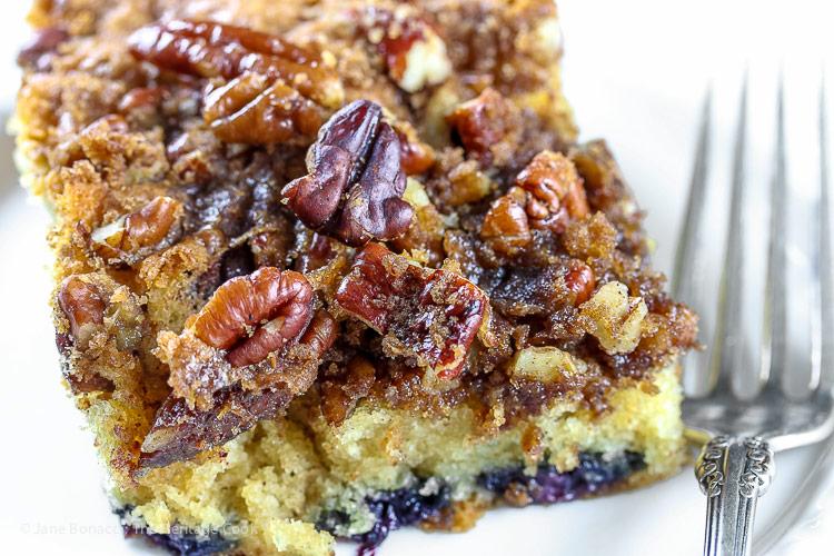 close up of pecan streusel on top of slice; Blueberry Coffee Cake © 2018 Jane Bonacci, The Heritage Cook