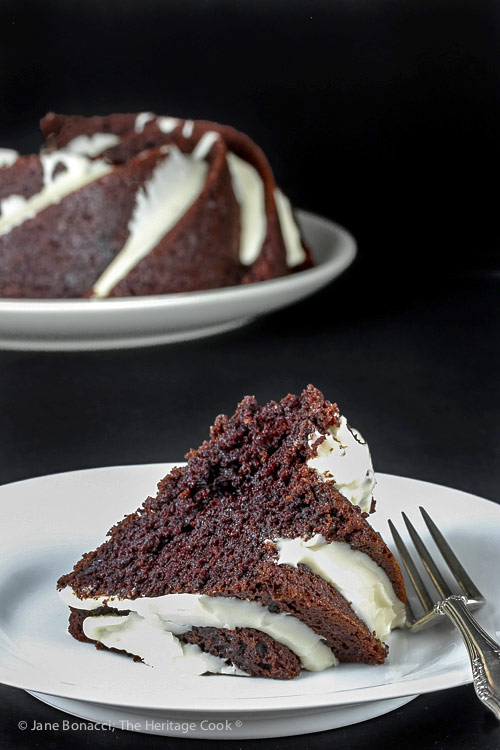slice on plate in front of whole cake in background; Deep Chocolate Zebra Cake (Gluten-Free) © 2018 Jane Bonacci, The Heritage Cook
