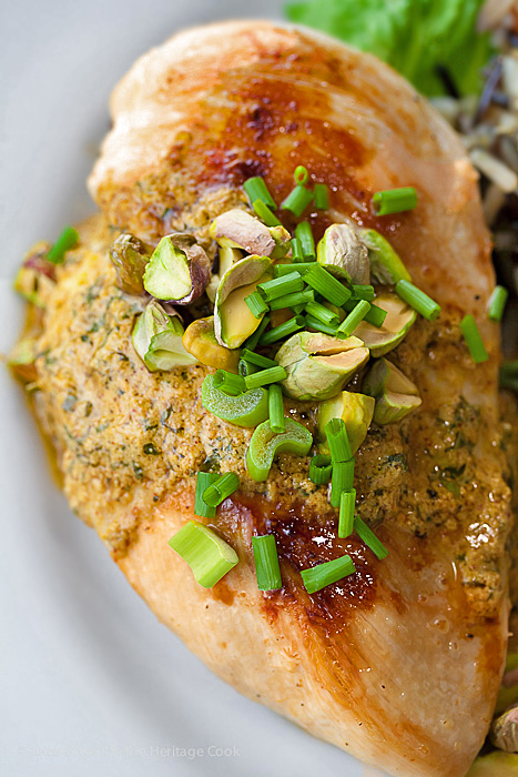 Top down view of chicken breast with harissa sauce and garnishes; Chicken with Harissa Yogurt Sauce and Pistachios © 2019 Jane Bonacci, The Heritage Cook