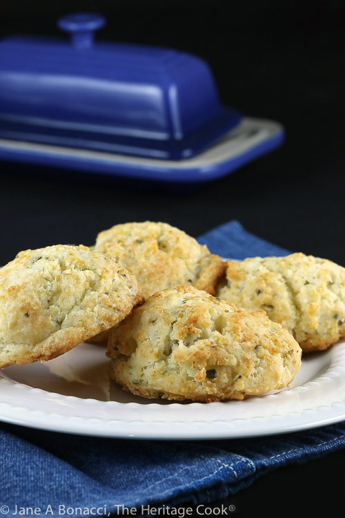 Plate of biscuits with butter dish behind