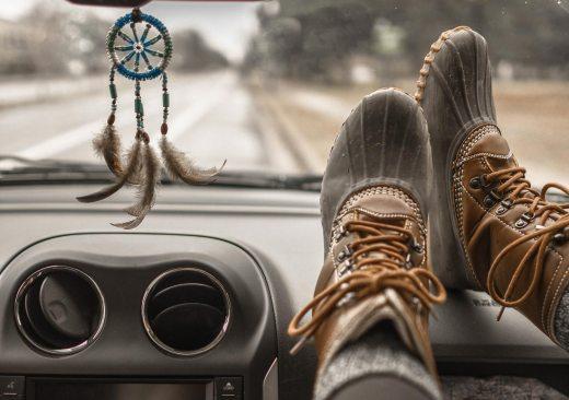 women's rain boots on car dashboard