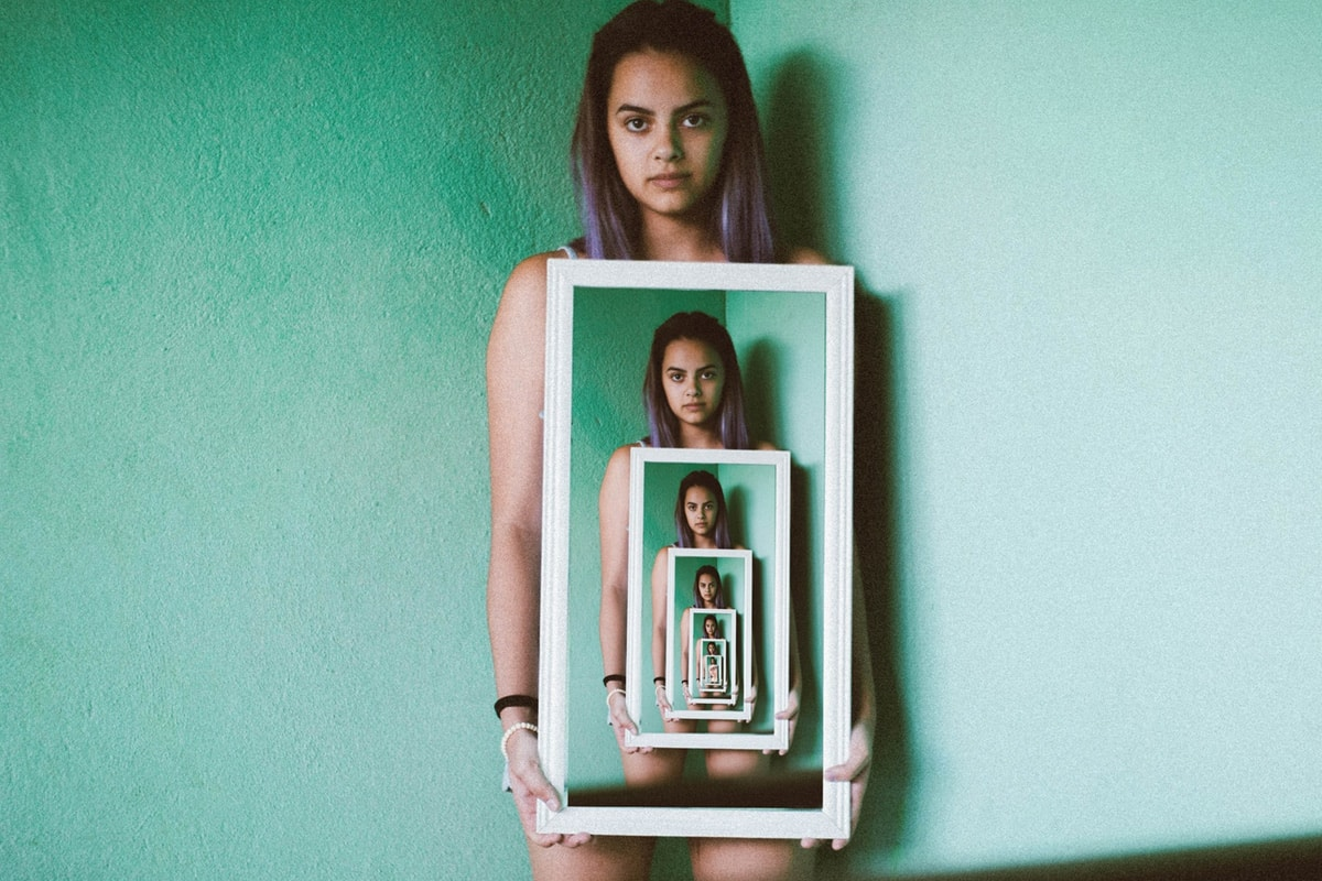 Girl holding a never-ending photo of herself.