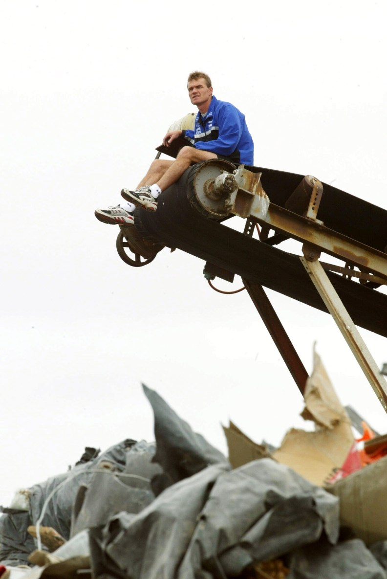19/03/2003  North Kangaroos coach Dean ''The Junk Yard Dog'' Laidley use to love a scrap on the ground as a player. Here on top of garbage conveyor. Digital Image. Football.