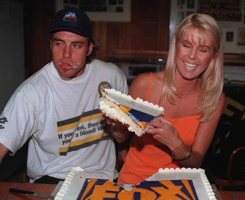 Mar97. Fox Sport celebrates its first birthday. Richmond Football club. Richmonds Matthew Richardson and Fox sport reporter Fiona Darmody celebrate with some cake. p/ /football