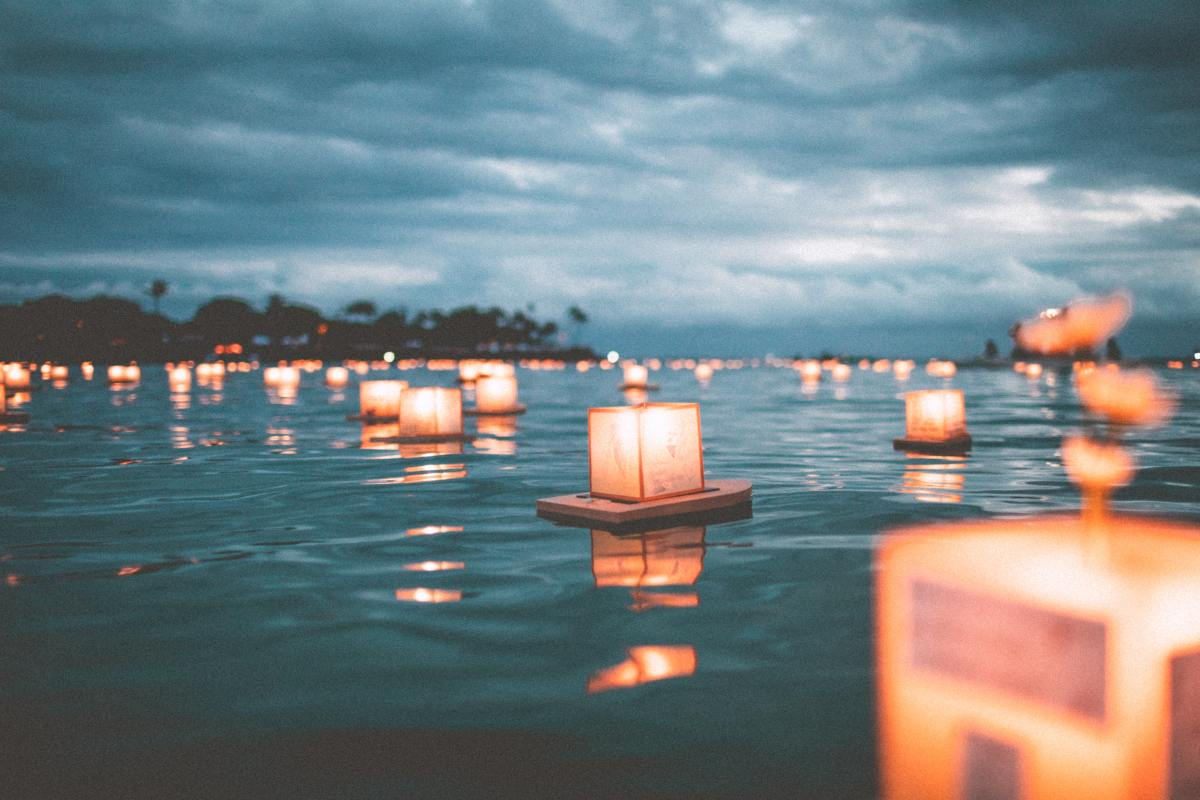A lantern afloat on the boundless ocean, spreading hope to shores unknown. The Ding Hai (丁亥) is the gift of influence