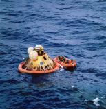 July 24: Splashdown! The crew hangs out in the lander's inflatable boat waiting to be picked up (Photo: NASA/Project Apollo Archive)