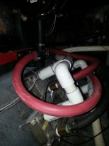 """Park some heat exchangers in the passsenger's foot well to heat the water in the tub using the engine."""