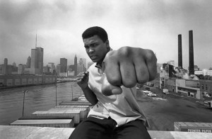 USA. Chicago, Ill. 1966. Muhammad ALI on a bridge overlooking the Chicago River and the city's skyline. (Photo Credit: © Thomas Hoepker/Magnum Photos)