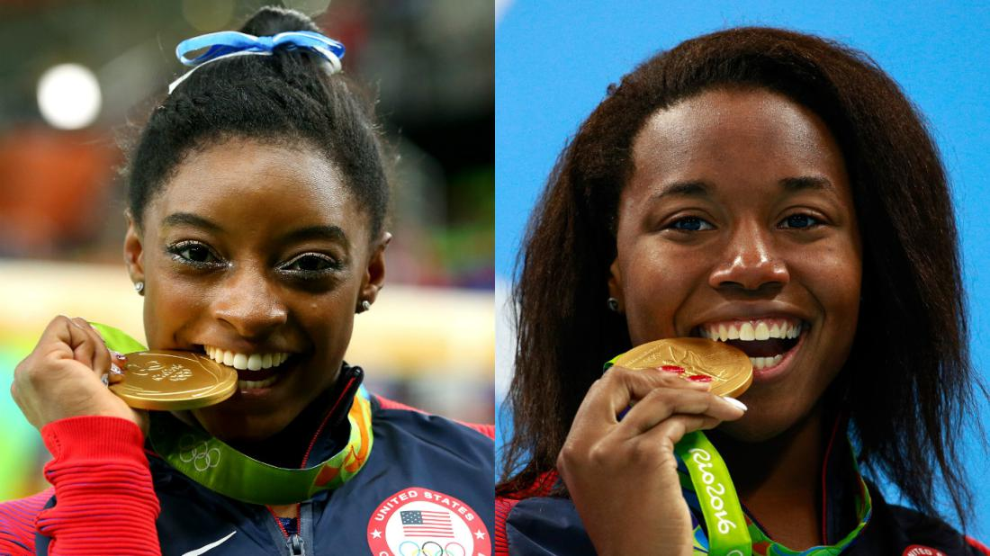 U.S. Olympians Simone Biles and Simone Manuel clinching their gold medals during the 2016 Olympics. (Courtesy photo)