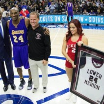 Kobe Bryant receives high school jersey from Lower Merion coach and Legendary Philadelphia 76er Julius Erving (Dr. J)
