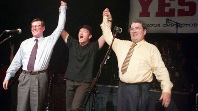 David Trimble, Bono and John Hume pictured together on stage in Belfast in 1998