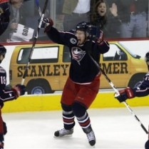 RJ Umberger, Christian Backman and Michael Peca celebrate an OT win over the San Jose Sharks Saturday at Nationwide Arena
