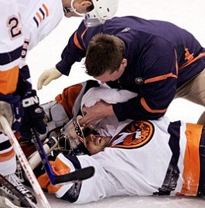 DiPietro in his familiar state of being attended to by the Islanders' training staff