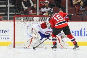 Reid Boucher scores the New Jersey Devils first shootout goal of the 2013-14 season against Peter Budaj (Ed Mulholland-USA TODAY Sports)