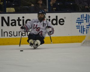 SSG Michael Cain takes the ice in Columbus. The USA Warriors participated in a shootout during the first intermission as the Jackets played the Capitals Thursday night. (USA Warriors: Ashleigh Bryant)
