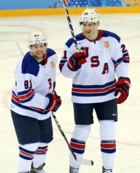 (Jayne Kamin-Oncea-USA TODAY Sports) Phil Kessel, left, seen here smiling after scoring a goal during the 2014 Olympics in Sochi, Russia, was inexplicably left on Team USA for the upcoming World Cup of Hockey in the fall.