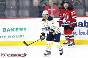 Brian Gionta skates against the New Jersey Devils (Paula Faerman Photography/paulafaermanphotography.org)