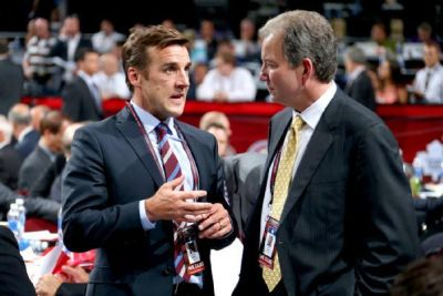 (THW file photo) George McPhee, left, is going to be the NHL's busiest general manager in 2017, building his Vegas Golden Knights team from scratch.