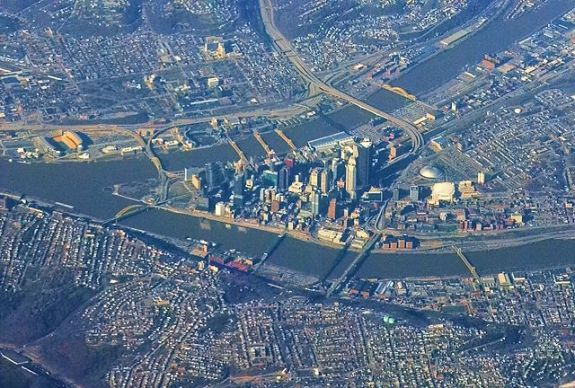 The Steel City from 30,000 feet. The Civic Arena is visible on the right side of the image. (Rob Reiring/Wikimedia)