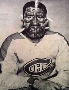 Cesare Maniago, displaying the mask former Ranger goalie Jacques Plante designed for him.