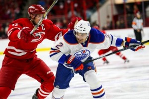 Edmonton Oilers defenseman Andrej Sekera (2) and Carolina Hurricanes center Eric Staal (12) during the NHL game between the Edmonton Oilers and the Carolina Hurricanes at the PNC Arena.