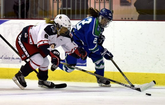 Danielle Ward of the Connecticut Whale and Sydney Kidd of the New York Riveters battle for a loose puck. (Photo Credit: Troy Parla)