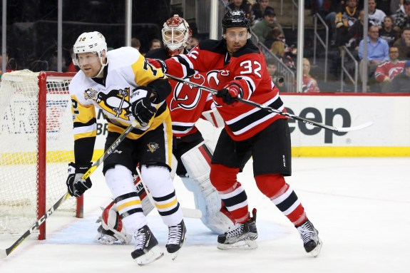 Devils defenseman Michael Kapla battles Patric Hornqvist of the Penguins  for position in front of the crease. (Photo Credit  Patrick Dodson New  Jersey ... 13bbe12ee