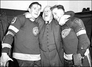 Jack Adams (centre) after Detroit's 1955 Stanley Cup Win