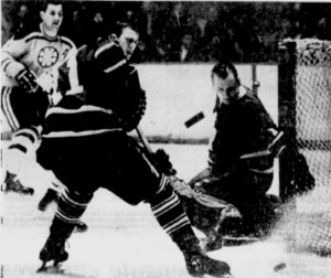 Johnny Bower eyes the puck he just deflected after a shot by Bruins Don Awrey.