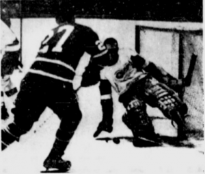 Roger Crozier makes one of his 38 saves last night on the Leafs' Frank Mahovlich.