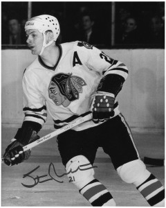 Stan Mikita, sported a helmet for last night's game with Toronto.