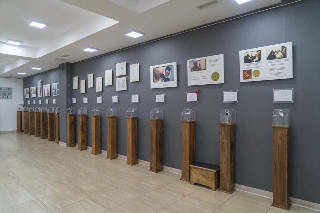 A wall of exhibits at the Micro Art Museum in Yerevan. Each piece of artwork is hermetically sealed in an organic glass container with a strong lens to see all the details of the artwork clearly.