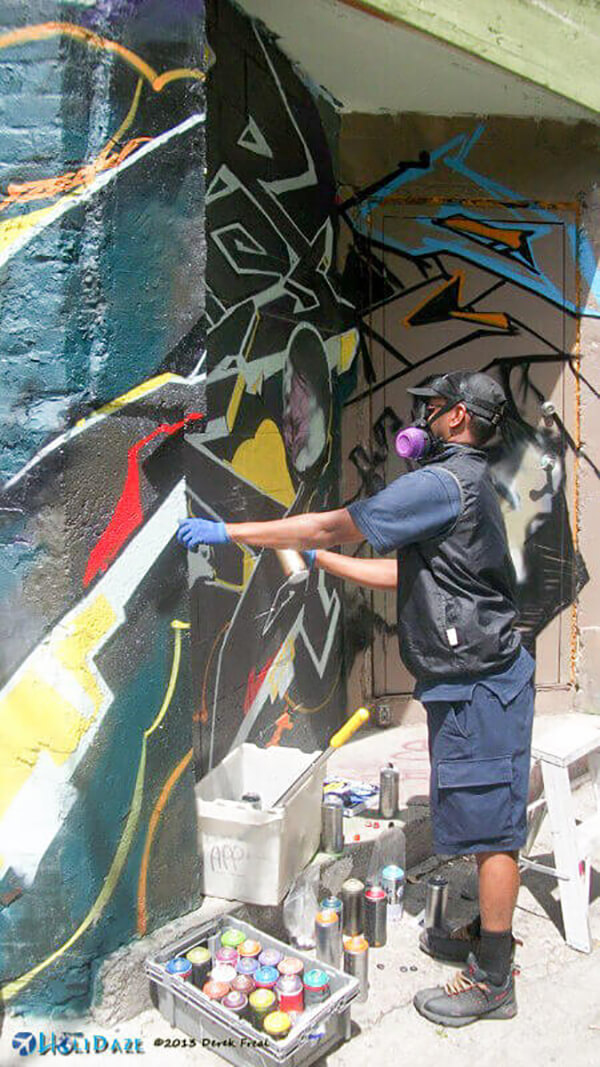 Graffiti artist at work in Kensington Market, Toronto, Canada