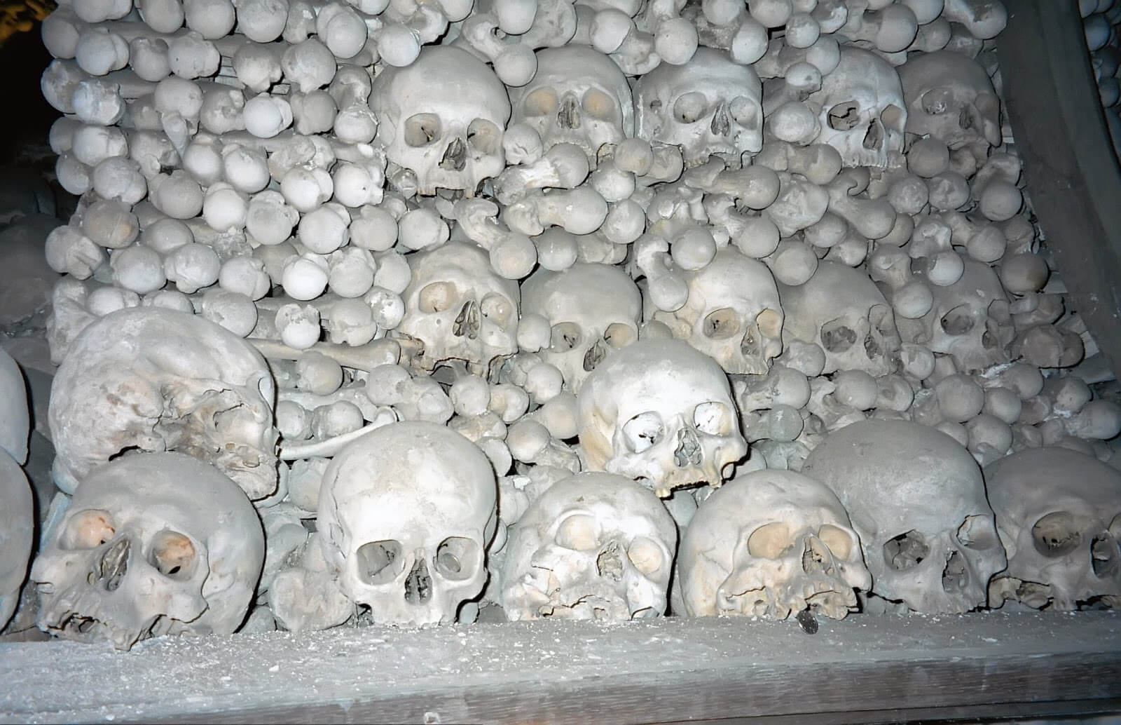Pile of skulls and femurs at Sedlec Ossuary in the Czech Republic