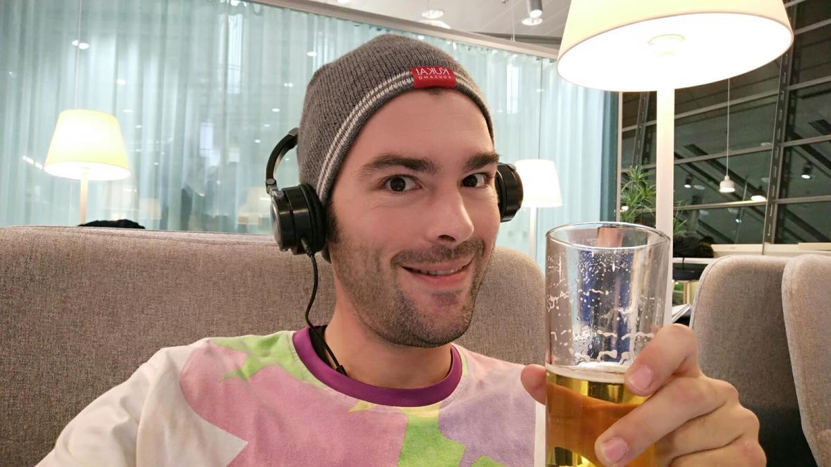 Enjoying free beer at the Finnair lounge in Helsinki, Finland