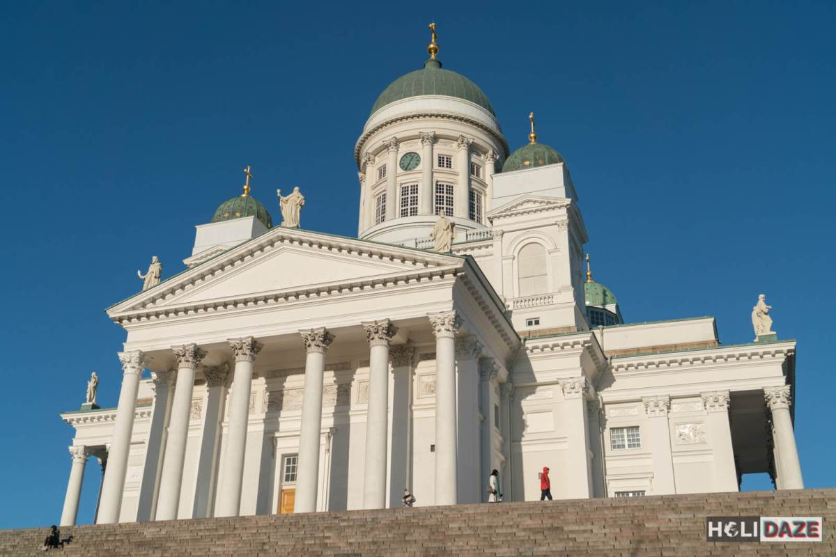 Exploring Helsinki Cathedral in Finland on a bright sunny day with perfectly blue sky
