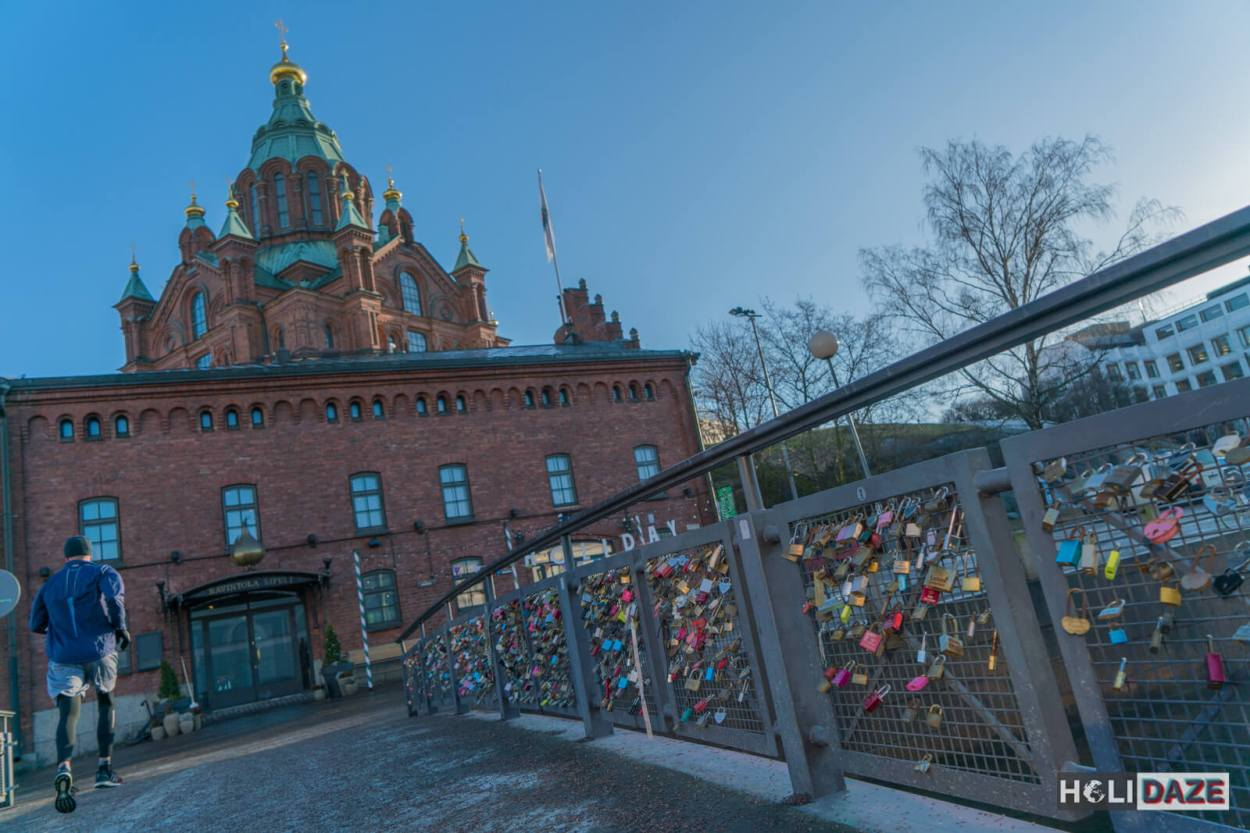 Jogger crossing the Helsinki love lock bridge