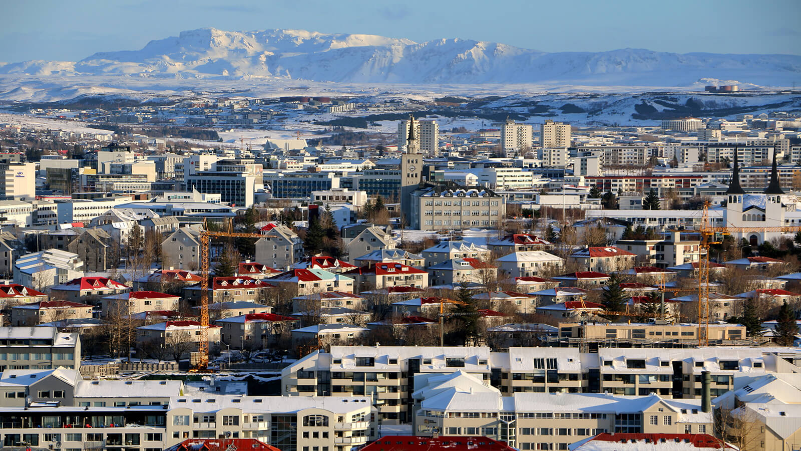 Rooftop mountain view of Reykjavik, Iceland, one of the best destinations for solo female travelers