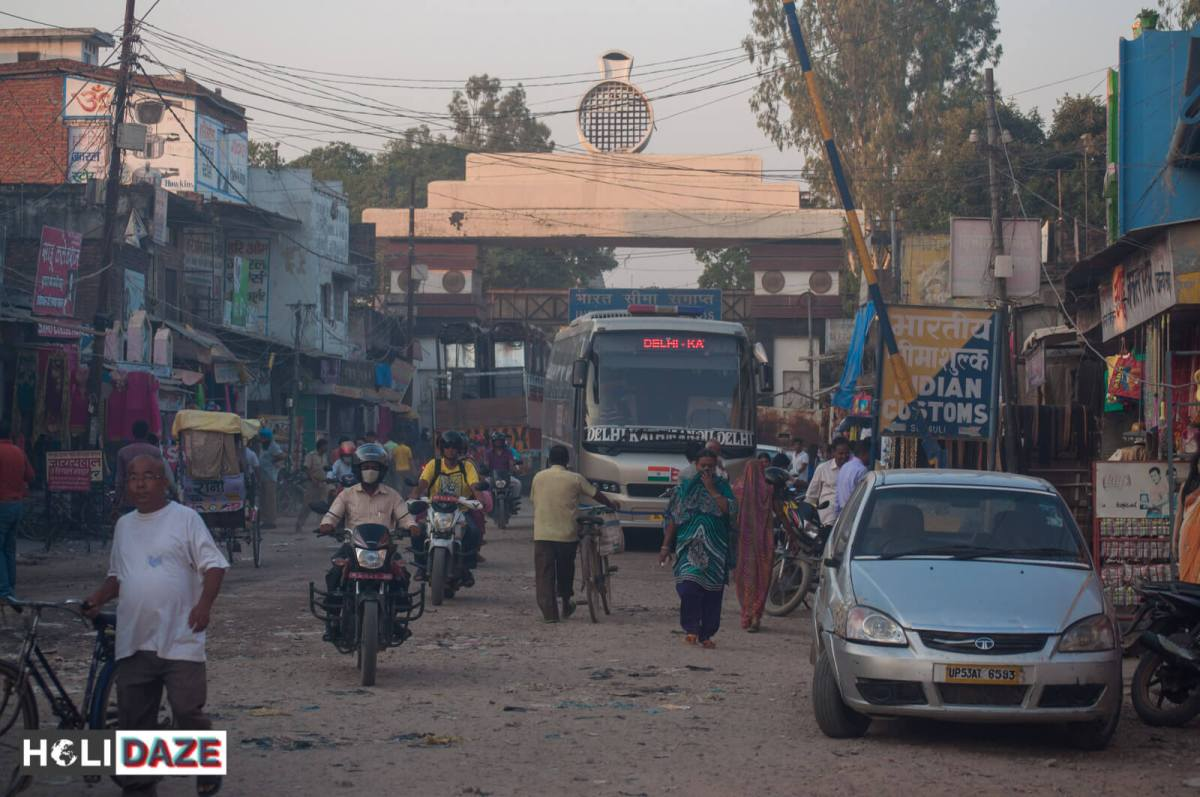 The India-Nepal border....and the Delhi to Kathmandu Express bus waiting to cross over.
