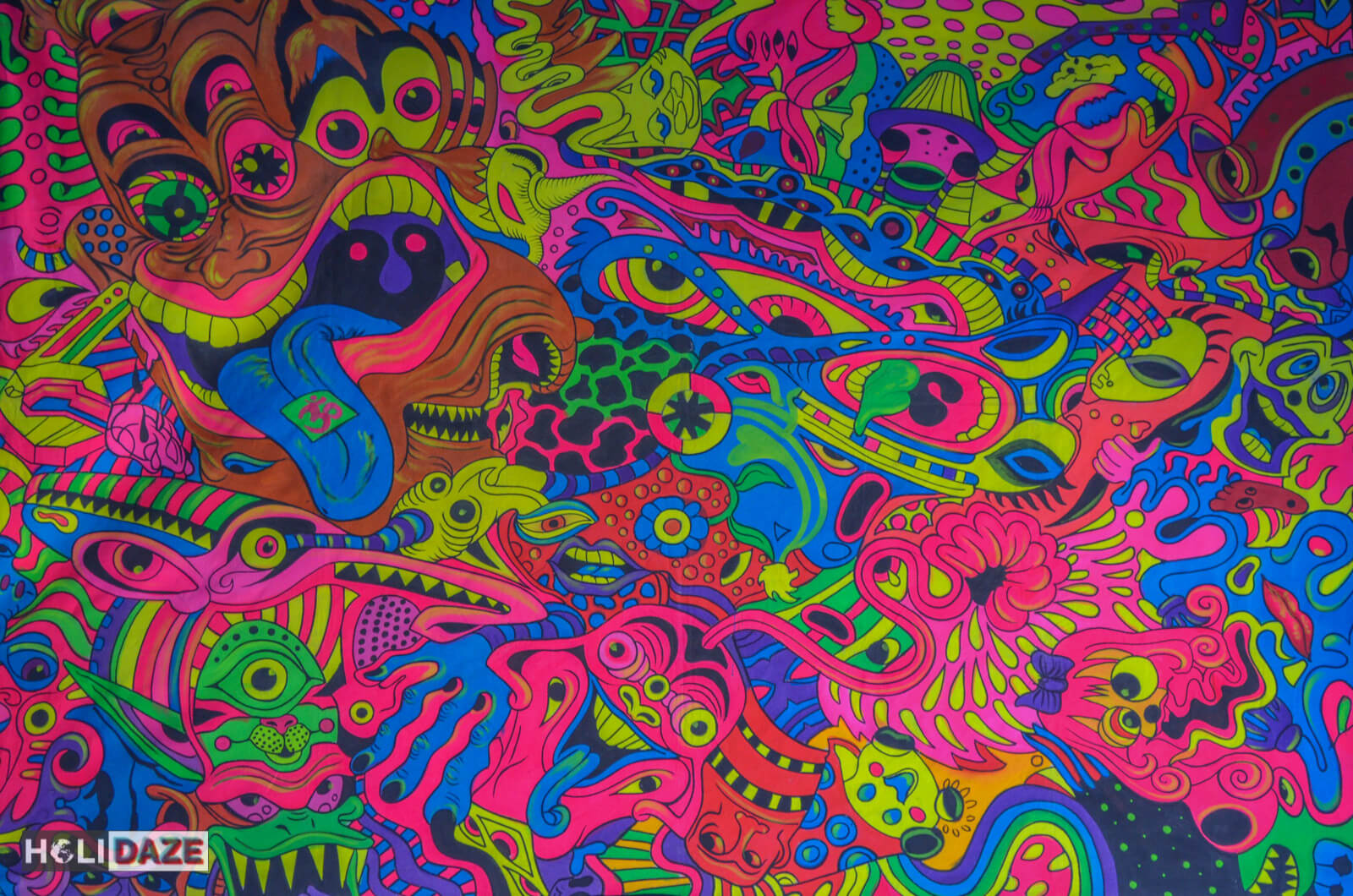 Colorful, trippy, psychedelic painting and art done by a Hindu priest and on display in his temple in Pushkar, India