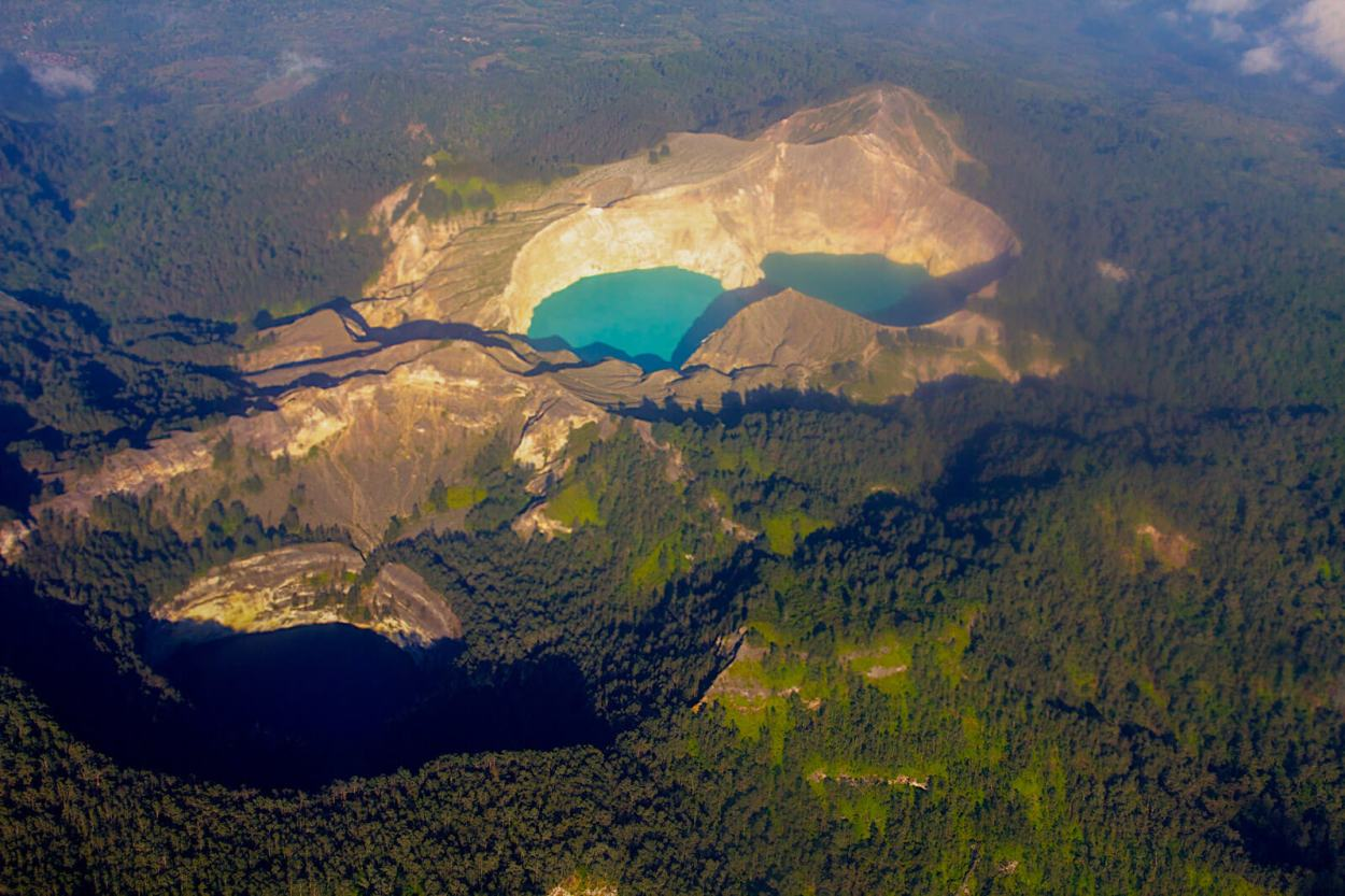 Aerial view of the three-colored lakes of Kelimutu Volcano, Flores, one of the unique and off the eaten path sights in Indonesia