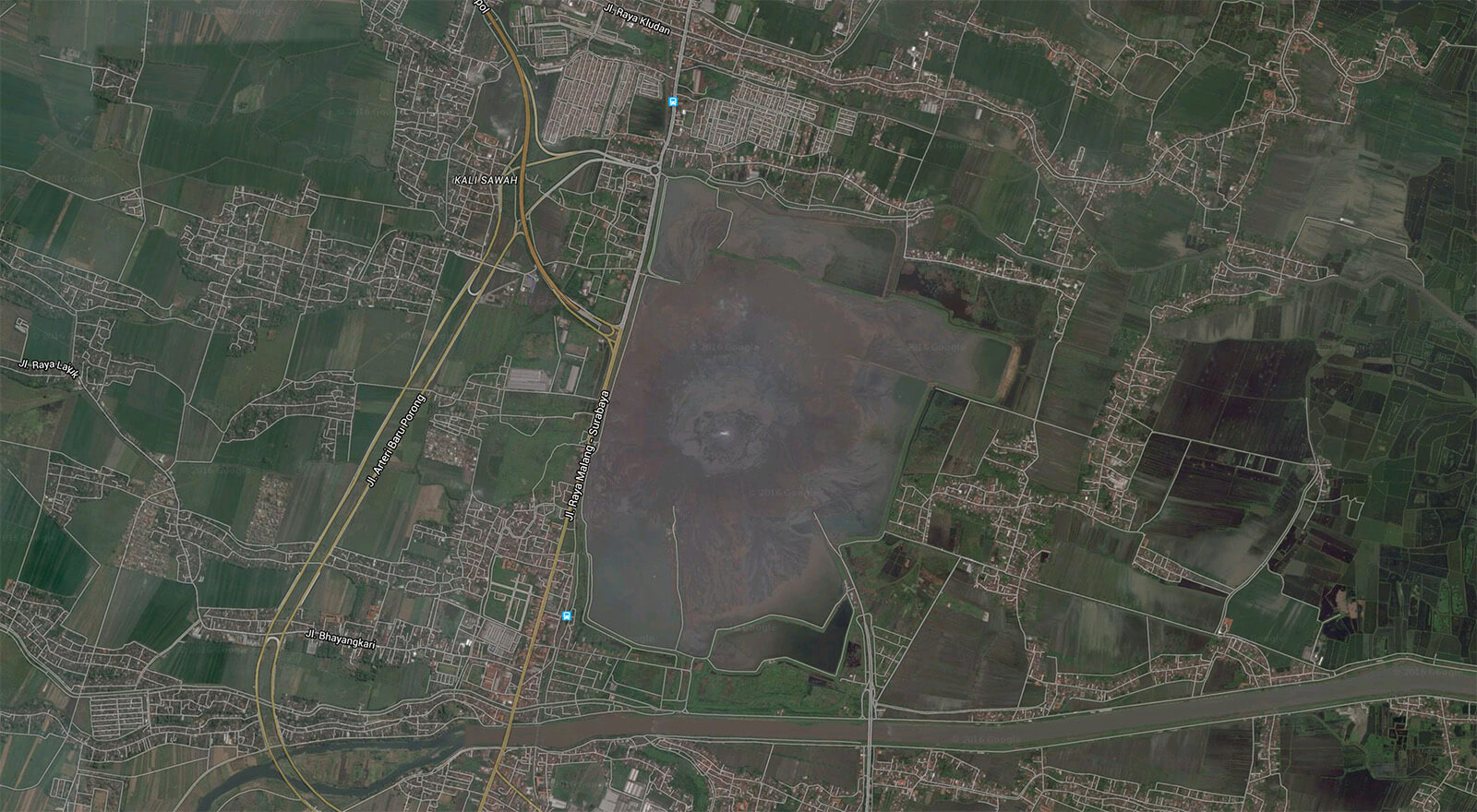 Aerial view of the Sidoarjo Mud Volcano as well as the damage to surrounding residents and roads