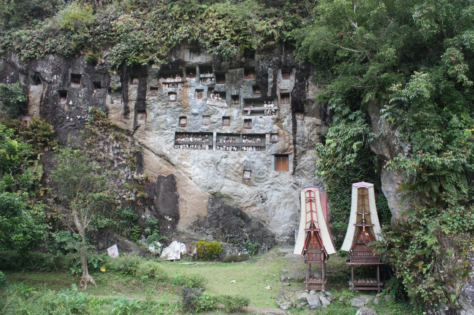 In Tana Toraja the deceased are buried on cliffs following elaborate ceremonies and rituals