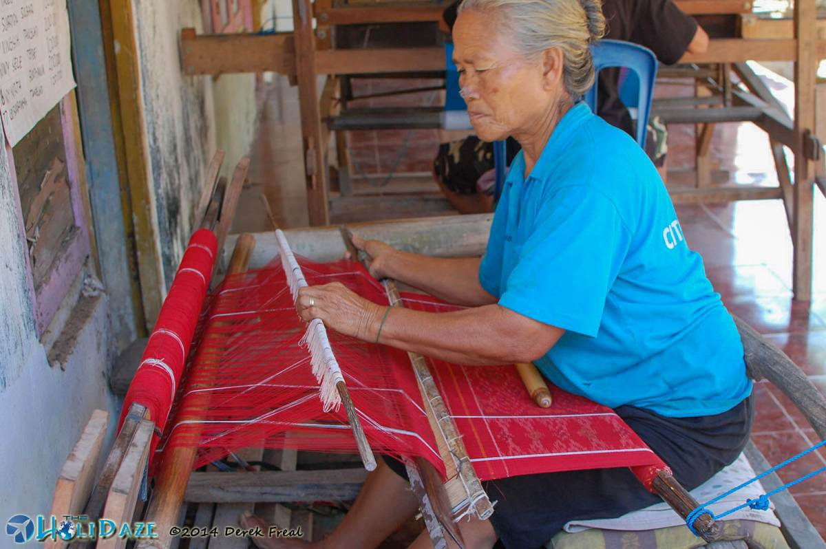 The village expert tenun weaver working the more traditional way, without the aid of a hand-operated machine
