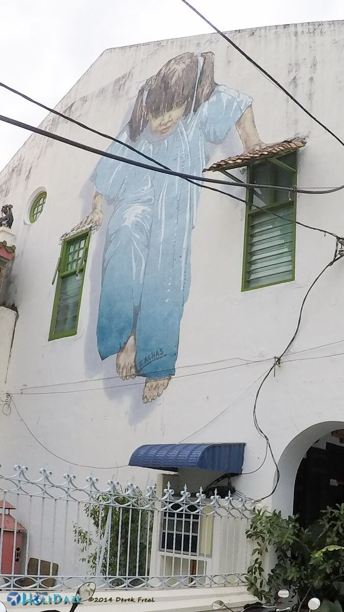 Huge street art mural in Penang covering entire side of a building