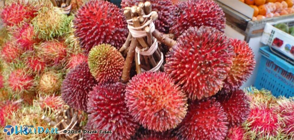 Pulasan in Malaysia, one of the amazing, weird and exotic fruits of Southeast Asia
