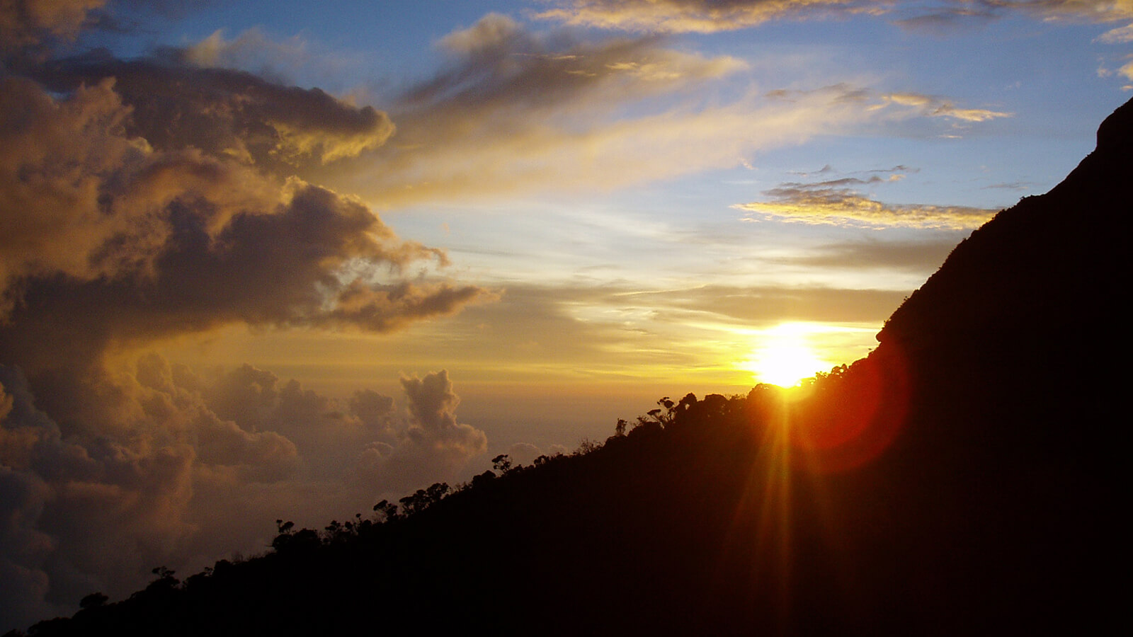 Watching the sunset from Laban Rata, the halfway point when climbing Mount Kinabalu, is a view you will never forget and one of the best hiking destinations of Southeast Asia