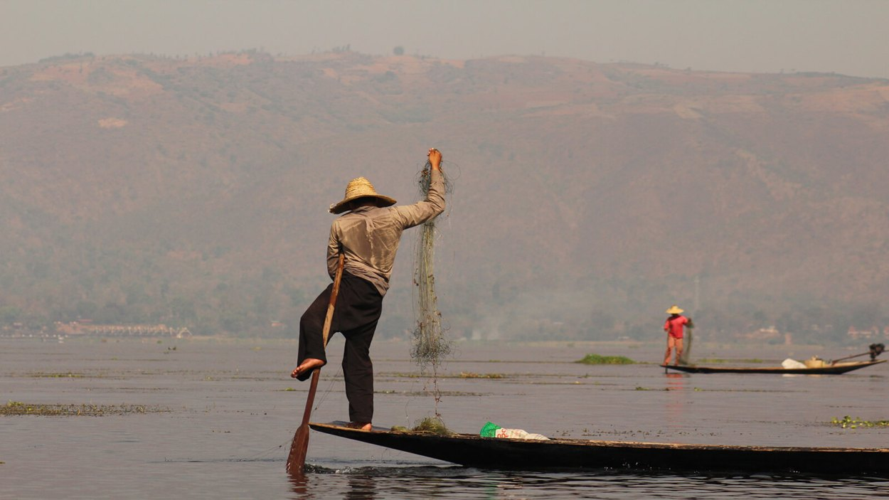 Locals at Inle Lake in Myanmar still fish using the traditional balancing act known as one-legged paddling, allowing them to stand, paddle AND fish simultaneously