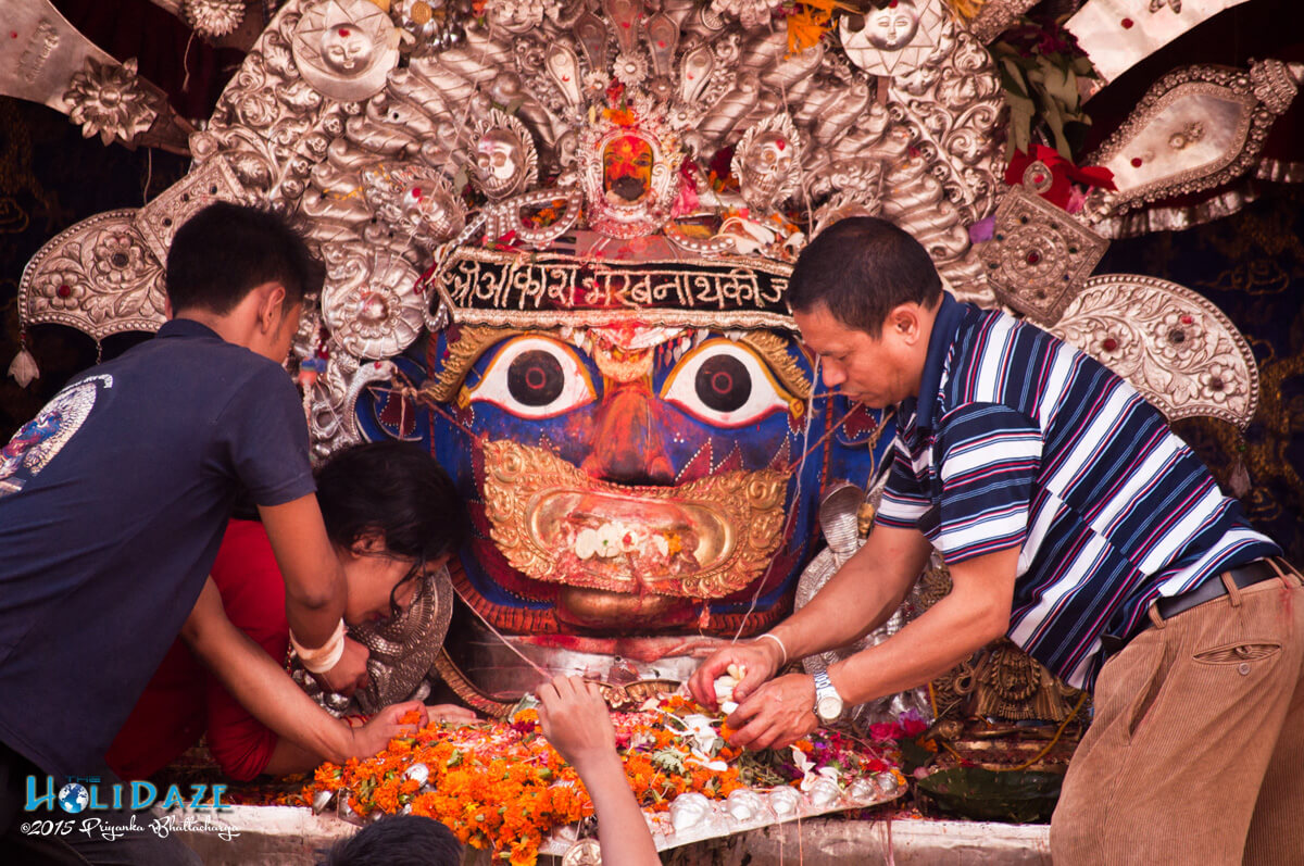 People offering prayers to the gods at the Indra Jatra festival 2015